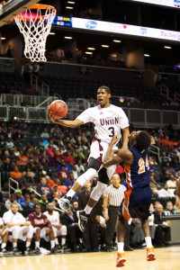 Virginia Union's Ray Anderson (#3) takes it to the hoop against Virginia State's Amiel Terry (#24)