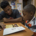 Clemson University Students Encouraging Reading at Black Barbershops